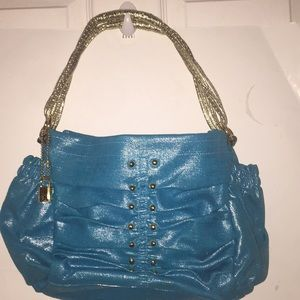 BCBG green/gold hand bag